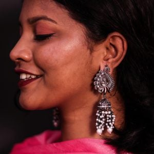 Kundan Peacock Jhumka Traditional Black Metal Earrings Lifestyle Image