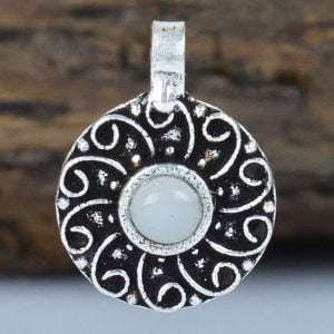 Silver Oxidised Round White Stone Clip On Nose Ring On Wooden Log