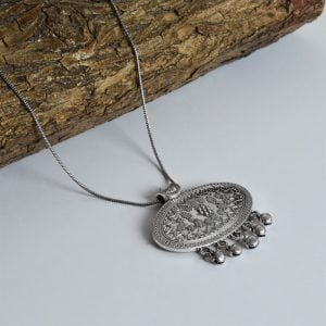 Silver Oxidised Plated Oval Ghungroo Pendant Chain Necklace On Wooden Log