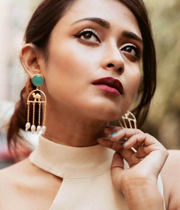 Gold Matte Plated Camel Motif Tassel Danglers – Turquoise Lifestyle Image