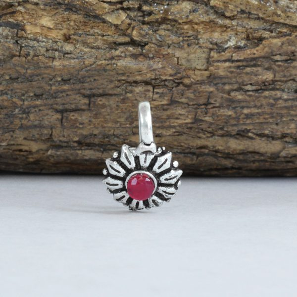 Oxidised Silver Pink Stone Studded Clip on Nose Pin on Wooden block
