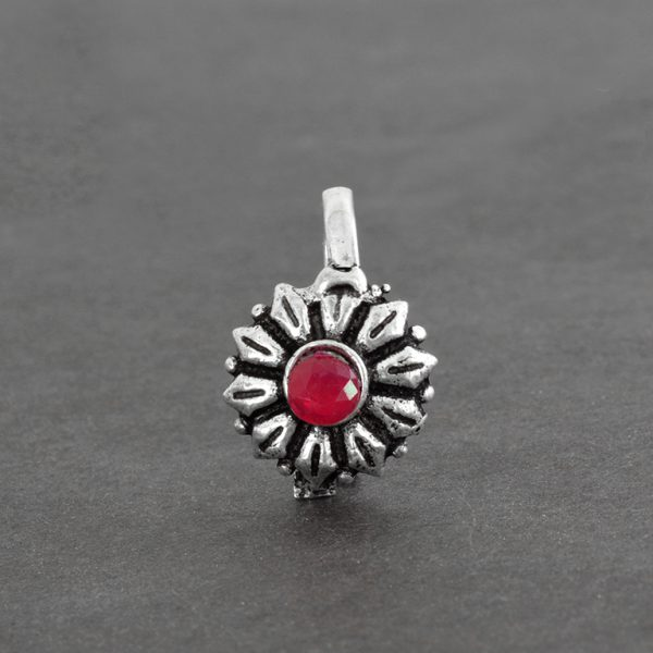 Oxidised Silver Pink Stone Studded Clip on Nose Pin on Black background