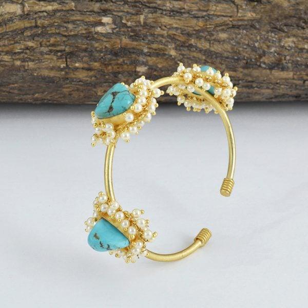 Golden Jadau Turquoise Stone Pearl Bangle – Adjustable On Wooden Log