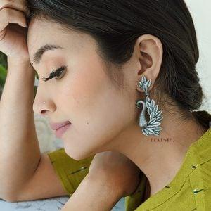 Silver Lookalike Handcrafted Brass Dangler Earrings Lifestyle Image