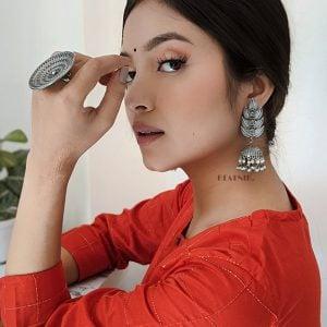 Silver Lookalike Handcrafted Brass Leaf Pearl Jhumki Earrings Lifestyle Image