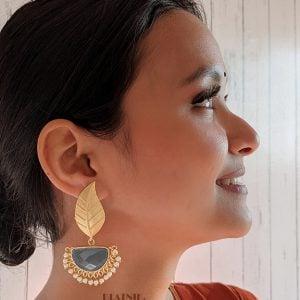 Golden Matte Leaf Stud Earrings – Charcoal Grey Lifestyle Image