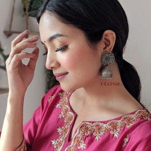 Handcrafted Brass Silver Lookalike Turquoise Stone Jhumki Earrings Lifestyle Image