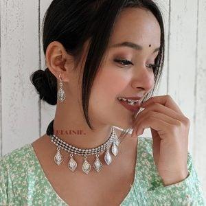 Oxidised Silver Dangling Motif Choker Necklace Earrings Set Lifestyle Image