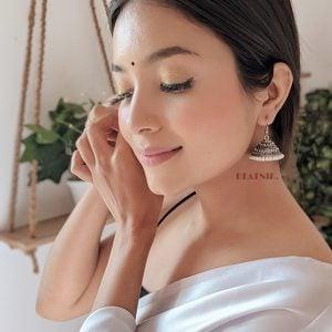 Oxidised Silver White Beads Jhumki Earrings Lifestyle Image