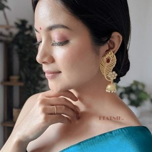 Gold Matte Feathered Red Stone Statement Jhumki Earrings Lifestyle Image