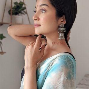 Silver Lookalike Brass Oxidised Statement Jhumka Earrings Lifestyle Image