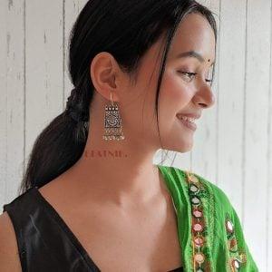Oxidised Silver Ganesha Elegant Hanging Earrings Lifestyle Image