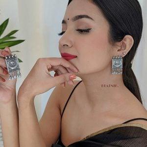 Silver Lookalike Brass Soorya Hanging Earrings Lifestyle Image