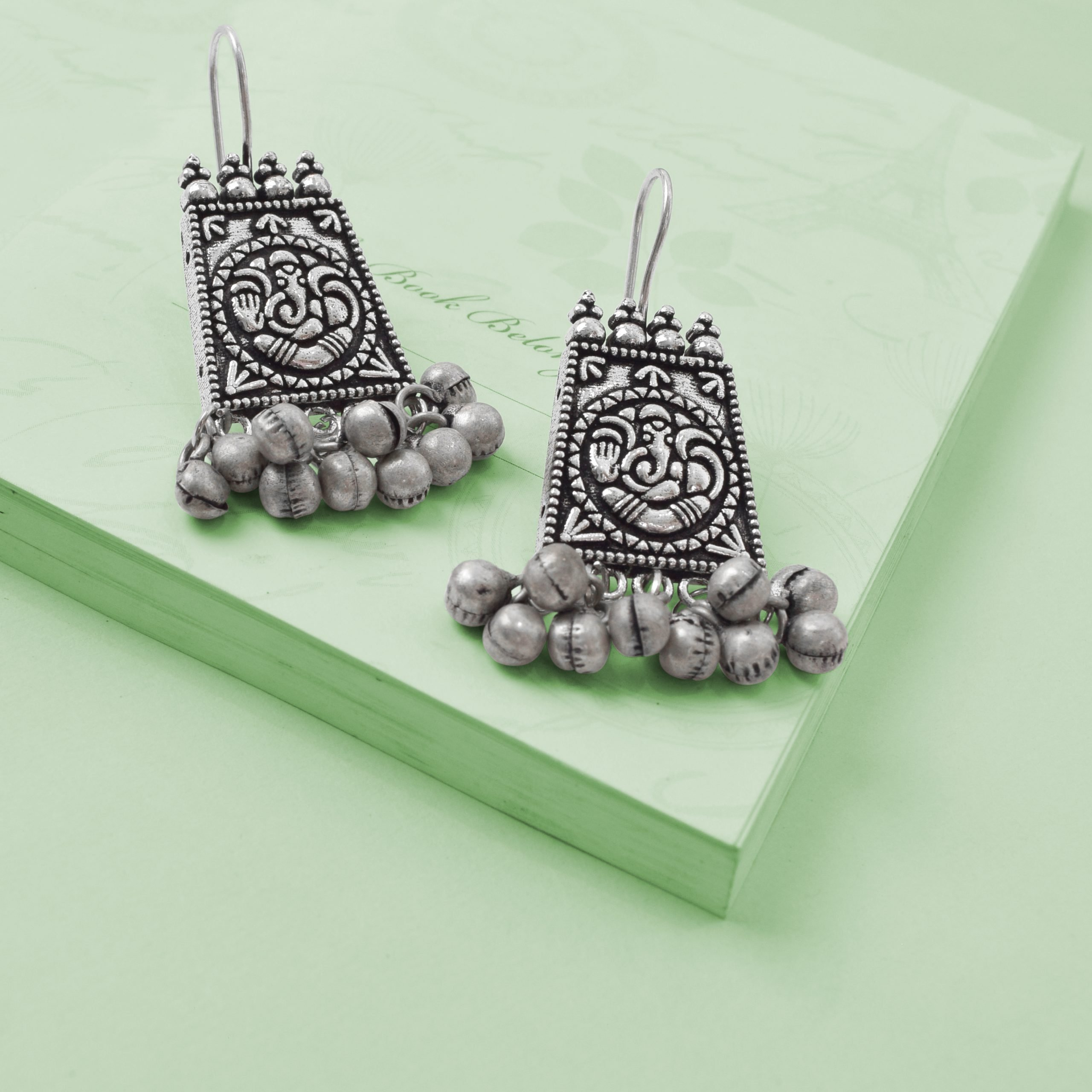 Oxidised Silver Ganesha Elegant Hanging Earrings Studio Image