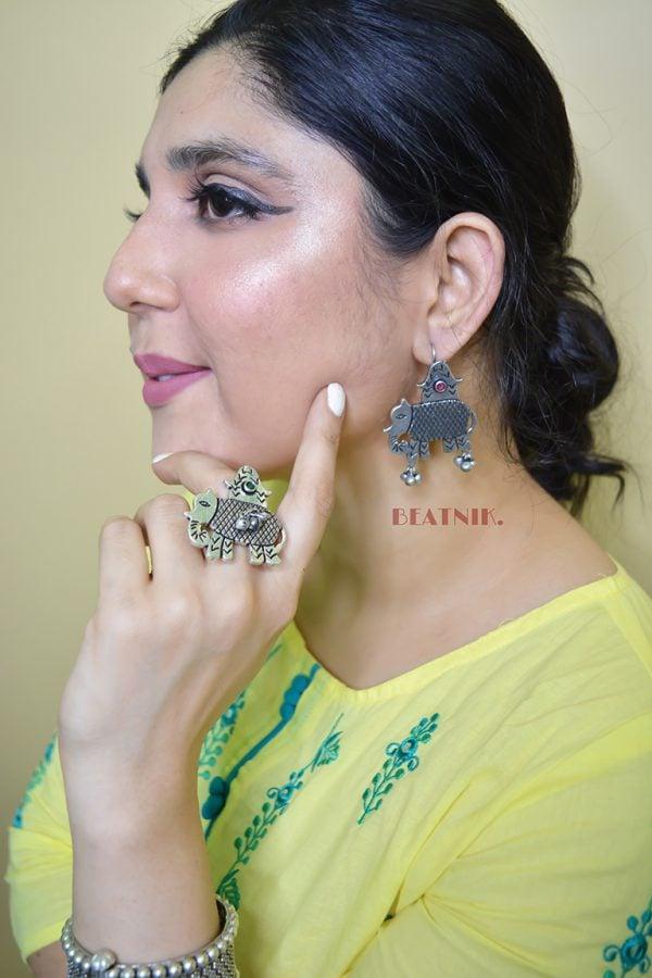 Silver Lookalike Brass Oxidised Elephant Motif Ghungroo Stud Earrings Lifestyle Image