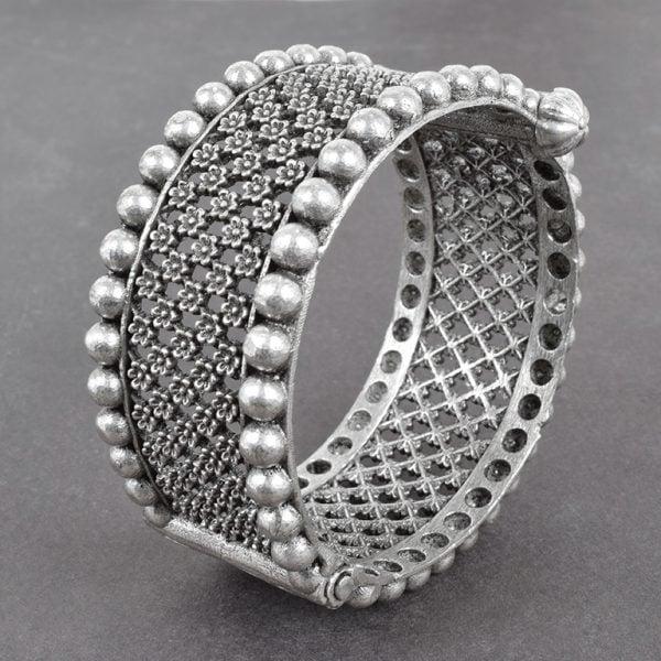 Silver Lookalike Brass Oxidised Round Jaali Boho Bangle - Adjustable On Black Background