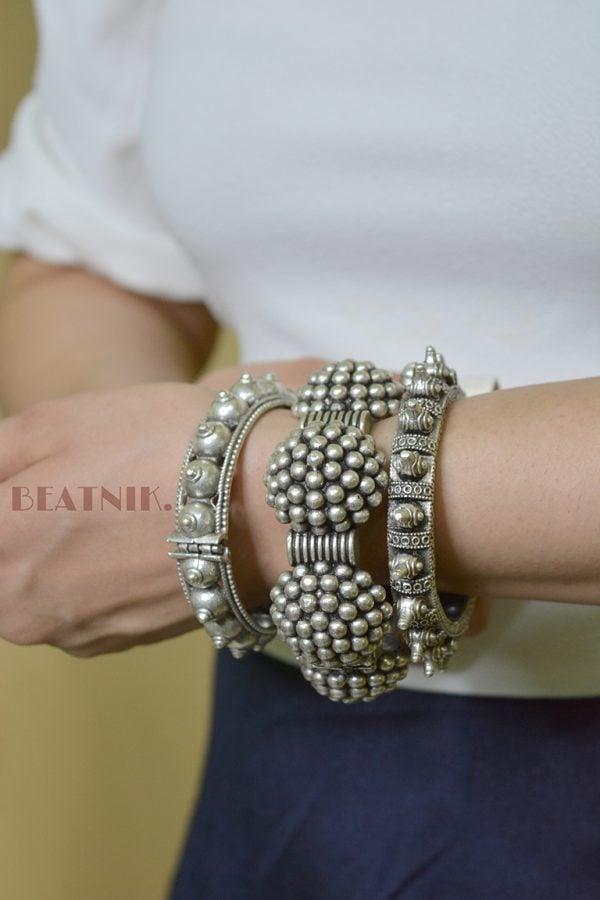 Silver Lookalike Brass Oxidised Spoke Motif Bangle - Adjustable Lifestyle Image