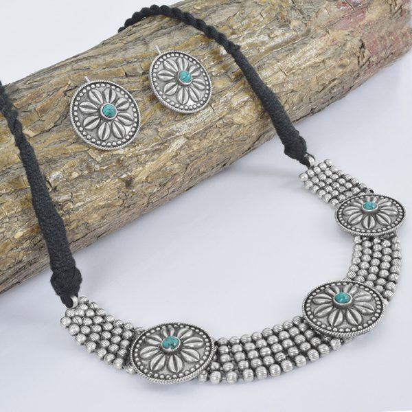 Silver Lookalike Brass Oxidised Statement Choker Necklace Earrings Set On Wooden Log