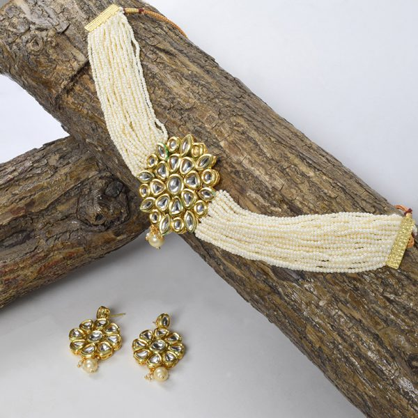 Traditional White Cheed Beads Kundan Choker Necklace Earrings Set On Wooden Log