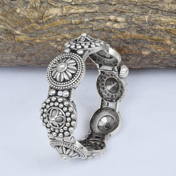 Silver Lookalike Brass Oxidised Boho Flower Motif Bangle – Adjustable On Wooden Log