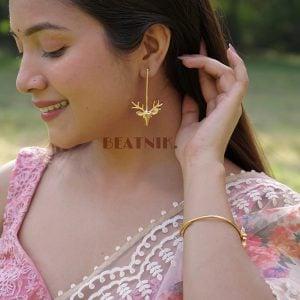 Gold Plated Brass Minimal Deer Stud Earrings Lifestyle Image