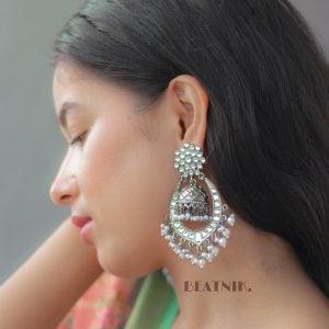Kundan Pearl Statement Hanging Black Metal Jhumki Earrings Lifestyle Image