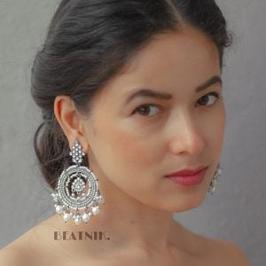 Kundan Pearl Traditional Statement Hanging Black Metal Earrings Lifestyle Image