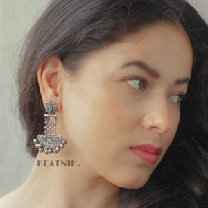 Silver Lookalike Brass Oxidised Afghani Statement Dangler Earrings Lifestyle Image