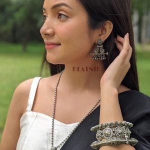 Silver Lookalike Brass Oxidised Antique Bohemian Ghungroo Stud Earrings Lifestyle Image