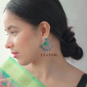 Silver Lookalike Brass Oxidised Bird-of-Juno Styled Earrings Lifestyle Image
