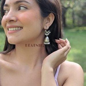 Silver Lookalike Brass Oxidised Crescent Motif Pearl Jhumki Earrings Lifestyle Image