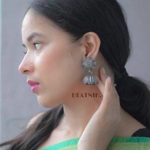 Silver Lookalike Brass Oxidised Stylish Floweret Statement Dangler Earrings Lifestyle Image