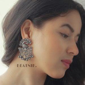 Silver Lookalike Brass Oxidised Stylish Peafowl Stud Earrings Lifestyle Image