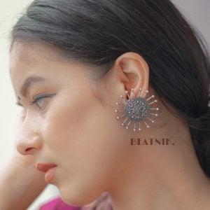 Silver Lookalike Brass Oxidised Stylish Spokes Stud Earrings Lifestyle Image