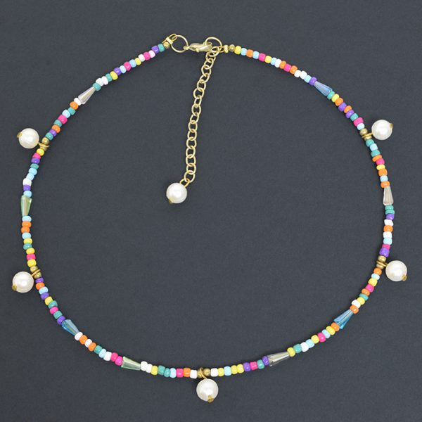 Hand Beaded Dainty and Colorful Pearl Necklace On Black Background