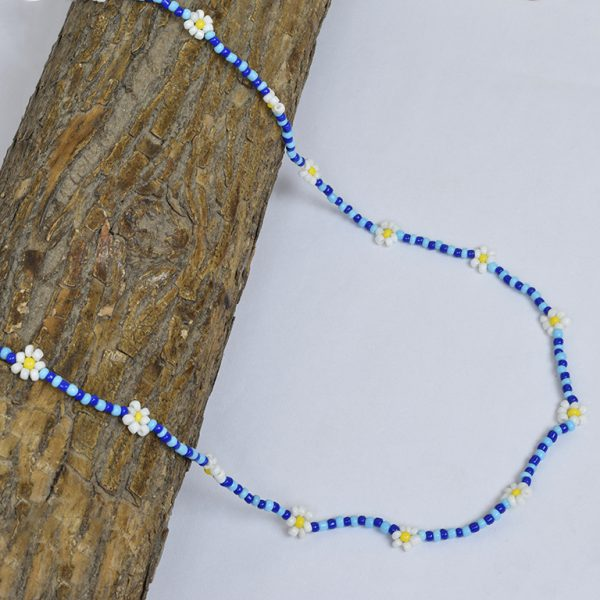 Hand-beaded Minimal Statement Necklace - White and Blue Bloom On Wooden Log