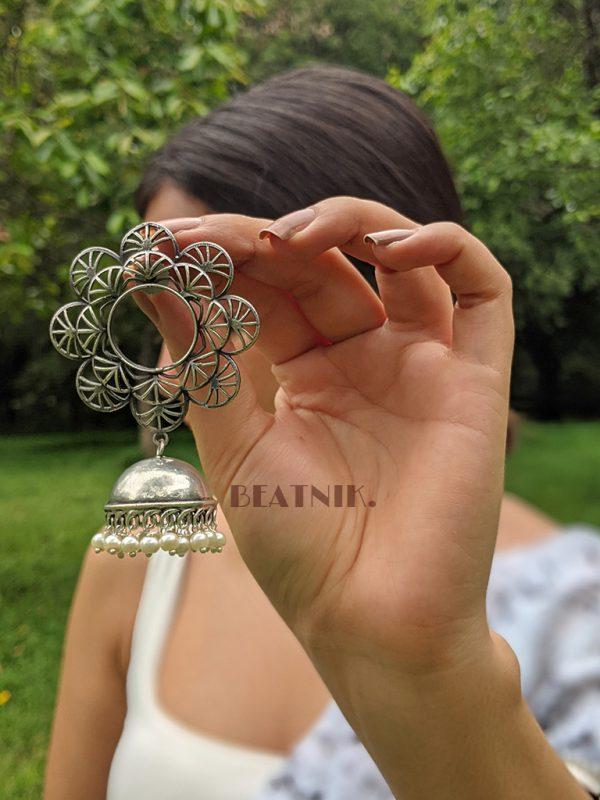 Silver Lookalike Brass Oxidised Statement Jhumki Earrings - Blossom Lifestyle Image