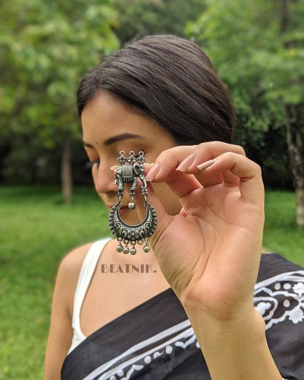 Silver Lookalike Brass Oxidised Traditional Elephant Jhumki Earrings Lifestyle Image